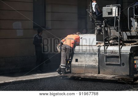 Road Under Construction, Operator Works On Paver