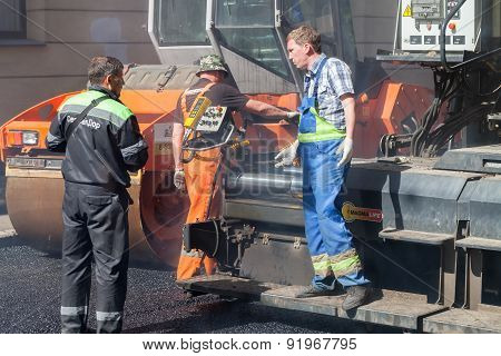 Quality Control Manager Talks With Paver Operator