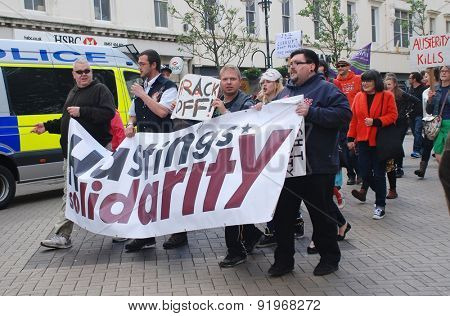 HASTINGS, ENGLAND - MAY 30, 2015: Protestors take part in a march against austerity and Government cuts following the Conservative party win in the General Election on May 7, 2015.