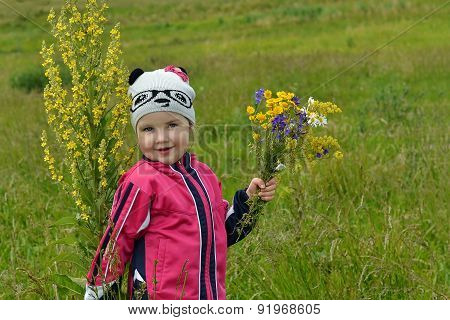High Plant And A Little Girl In A Meadow