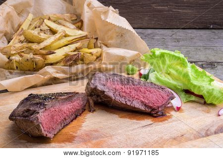 Medium Rare Grilled Top Rump Steak With Roasted Potatoes And Salad