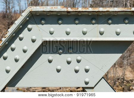 Angled Steel Girder With Rivets On Painted Surface.