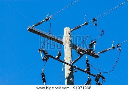 Old Wood Telephone Pole With Metal Bar And Insulators.