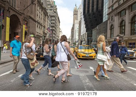 NEW YORK, USA - CIRCA MAY 2015: Pedestrians and Vehicles move along 5th Avenue in New York City.