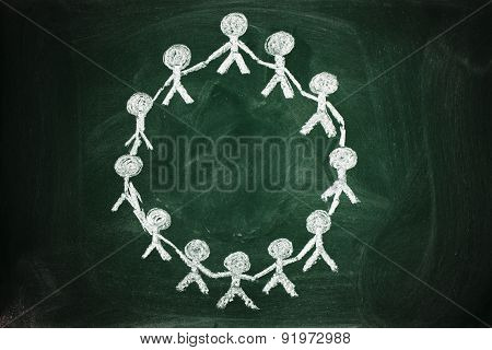 cooperation concept on chalkboard United people holding hands