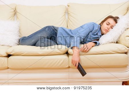 Girl sleeping in front of TV