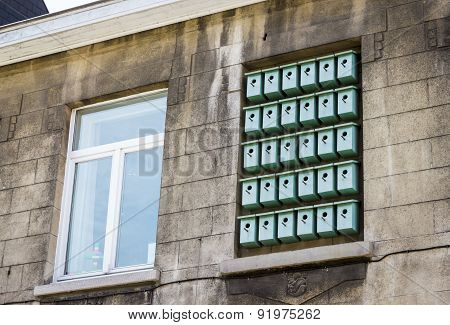 Facade Of Bilding With Birdhouses In Window  In Ghent, Belgium