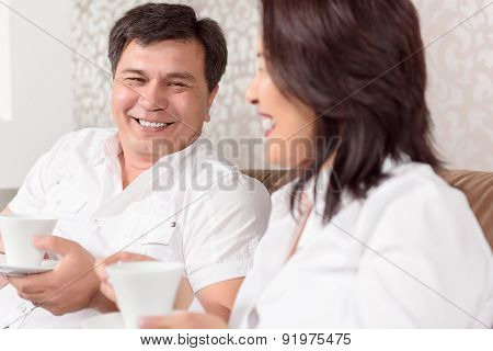 Intercultural family drinking coffee