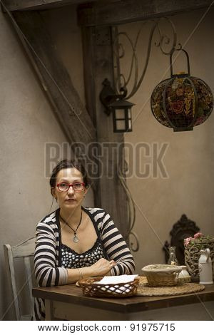 Portrait of a young woman in an old cafe.