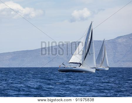 Sailing regatta. Sailing in the wind through the waves at the Aegean Sea in Greece. Luxury yachts.