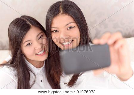 Two Asian girls doing selfie