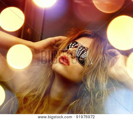 fashion and people concept - beautiful woman in sunglasses in elevator