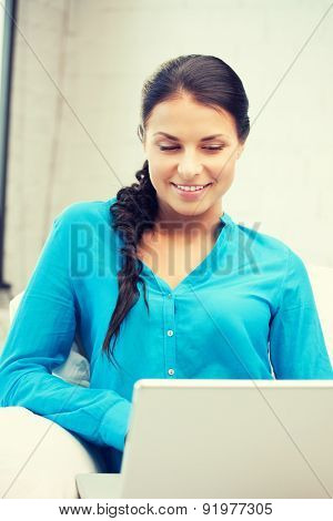 picture of happy woman with laptop computer.