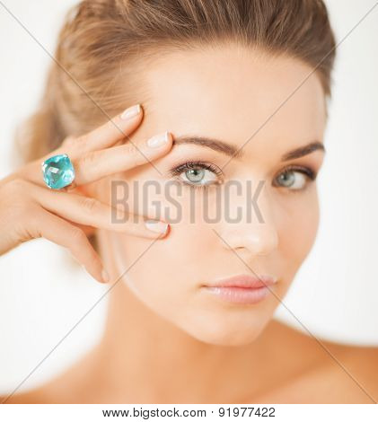 picture of beautiful woman with one jewelry ring