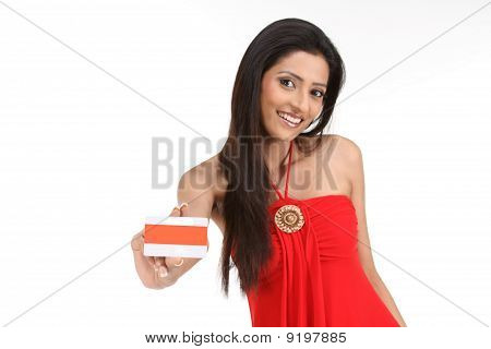 Woman showing her orange credit card