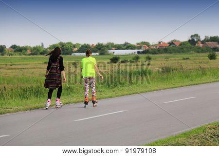women on rollerblades