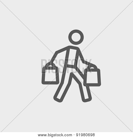 Man carrying shopping bags icon thin line for web and mobile, modern minimalistic flat design. Vector dark grey icon on light grey background.