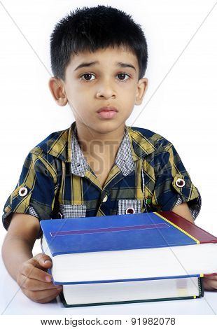 Portrait of Depressed Indian School Boy with Books