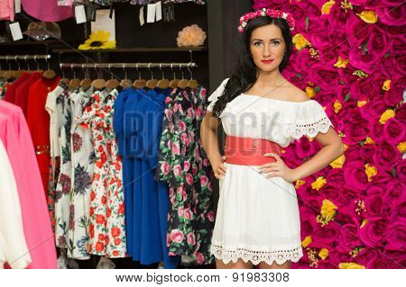 the girl in a white dress in a clothing store