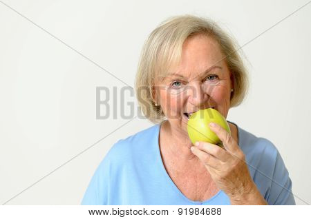 Happy Healthy Senior Lady With A Green Apple