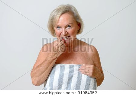 Elderly Lady Using Interdental Brush