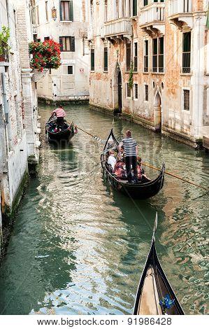Venetian Gondolas With Tourist
