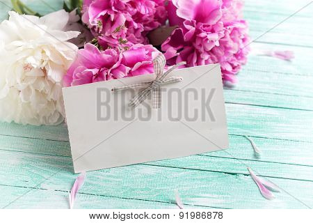 Postcard With Fresh Peonies Flowers And Tag