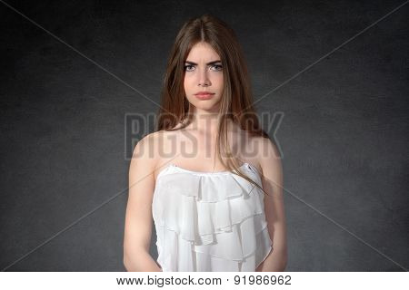 Woman Shows A Grudge Against A Dark Background