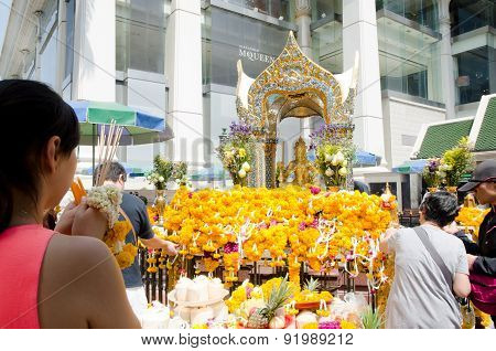 Traveler Pray Respect To The Four-faced Brahma Statue in Bangkok