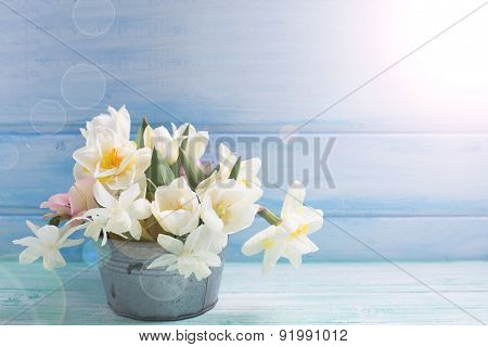 Background With Fresh Narcissus And Tulips In Aged Bowl