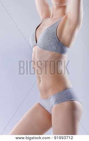 Slim Woman In Gray Underwear.