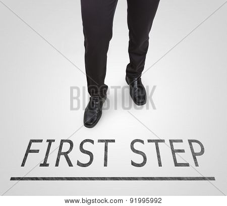 Businessman standing wearing court shoes on first step line.