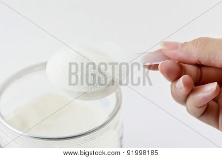 Collagen Protein Powder On Spoon Measure Isolate On White Background.