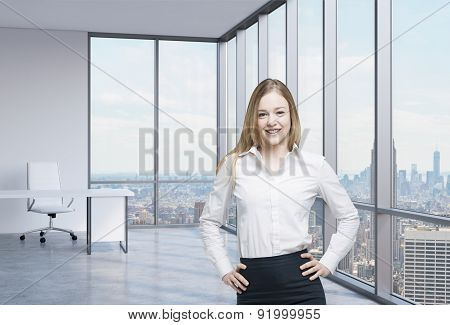 Beautiful Smiling Employee Is Standing In The Office With New York Panoramic View. A Concept Of The