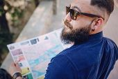 image of beard  - handsome bearded stylish man travels with map - JPG