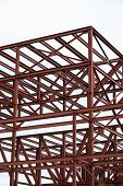stock photo of girder  - Unfinished industrial building with an iron girder structure - JPG
