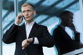picture of people talking phone  - Man talking on the phone before meeting horizontal - JPG