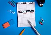 picture of impossible  - Impossible word close up on notebook page - JPG