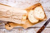 picture of french culture  - French Baguette sliced on cutting board top view - JPG