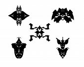 image of symmetry  - Group of five fantasy symmetry black shapes on a white background - JPG