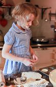 picture of pastry chef  - Young girl who is cutting out pastry with pastry cutter - JPG
