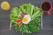 image of scrambled eggs  - Breakfast with scrambled eggs bacon greens vegetables on the black plate - JPG
