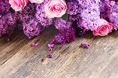 image of purple rose  - Purple Lilac flowers with pink roses on wooden background - JPG