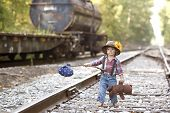 foto of railroad car  - Adorable toddler on the railroad tracks and dressed as a hobo - JPG