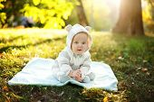 picture of pretty-boy  - Cute caucasian baby boy in park looks at camera - JPG