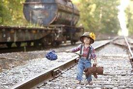 picture of hobo  - Adorable toddler on the railroad tracks and dressed as a hobo - JPG
