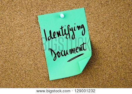 Identifying Document Written On Green Paper Note