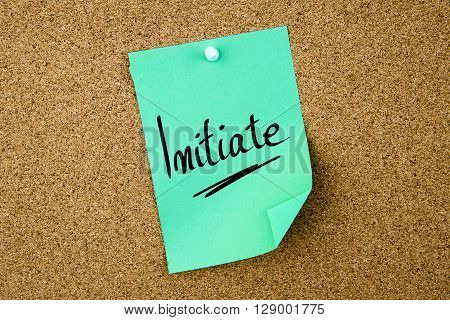 Initiate Written On Green Paper Note