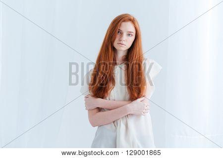 Charming redhead woman looking at camera