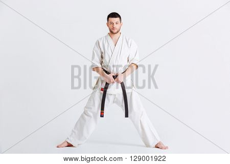 Man in kimono looking at camera isolated on a white background